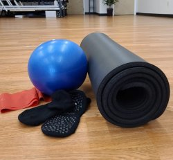 Bundle: Stability Ball, Sticky Socks, Theraband, and Mat